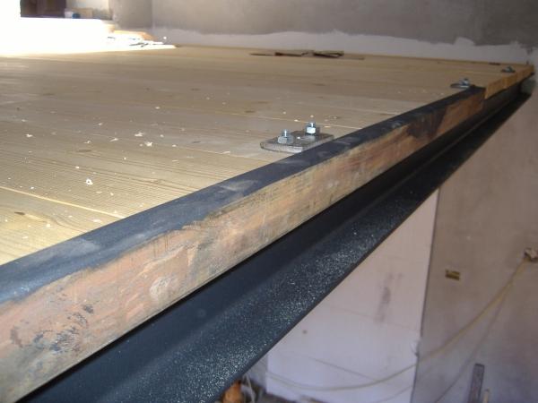 Realizzazione di un soppalco in ferro e legno come fare for Bloccare i piani di costruzione del garage