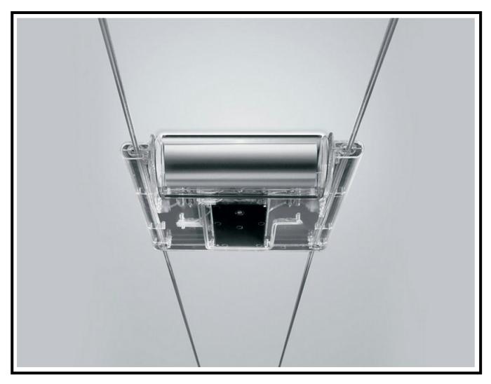 Una illuminazione interna a faretti su binari in acciaio