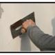 A Realizzazione di intonaci interni con finitura a gesso