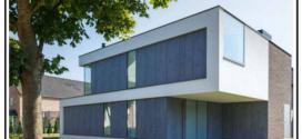 Un pannello di fibrocemento ecologico per facciate ventilate formato da cemento e vari altri materiali minerali e di rinforzo